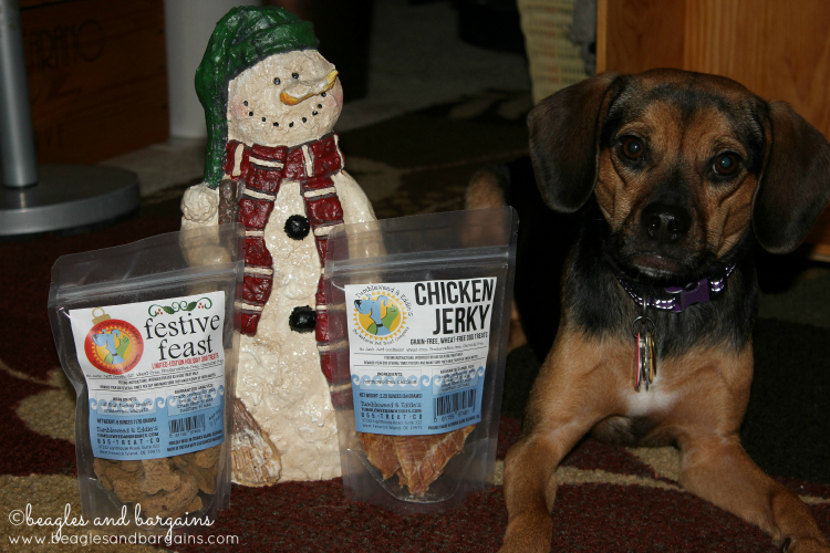 Luna would rather be eating these tasty treats from Tumbleweed & Eddie's than posing with them.