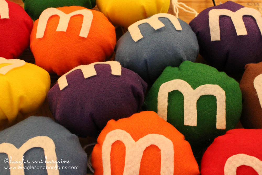 "DIY M&Ms Halloween Costume for Dogs - Step 8 - Cut out ""M""s for each M&M"