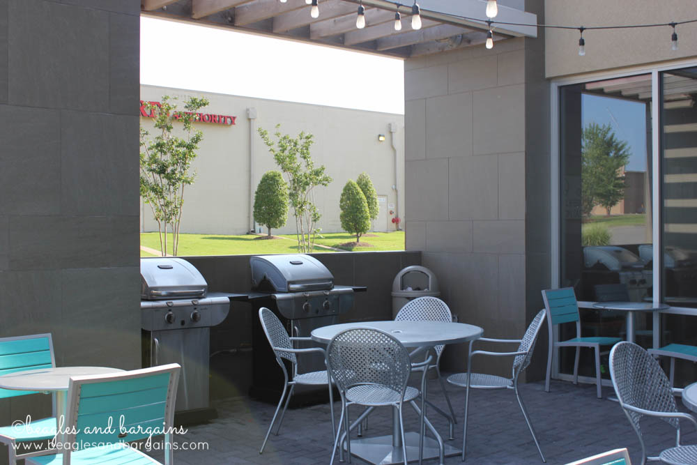 BBQ grills and a pool are just a few Home2 Suites amenities.